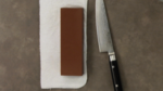 Thumbnail knife sharpening with a whetstone